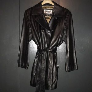 Mid length leather coat.